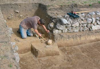 Excavating an early medieval human burial at Brownslade Farm, Pembrokeshire in August 2006. ©Dyfed Archaeological Trust