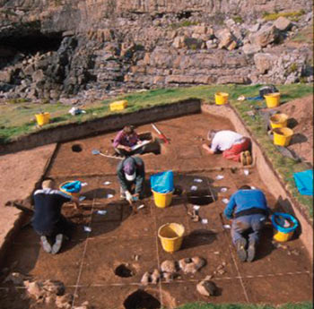 Excavation on Burry Holms, Gower, Swansea, investigating an early Mesolithic settlement site beneath a later prehistoric roundhouse. ©National Museum of Wales