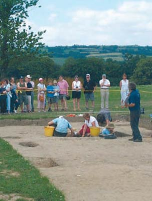 Visitors being shown around the excavations of the newly discovered Roman forts at Llandeilo, Carmarthenshire, in July 2005.   ©Dyfed Archaeological Trust